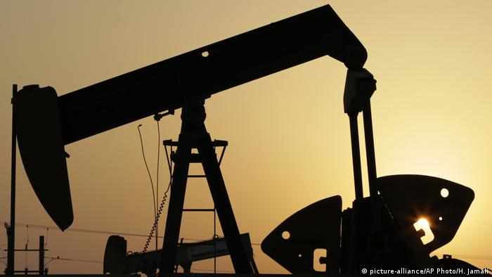 An oil pump at sunset in Bahrain's lone oil field.