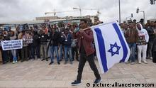 An African asylum seeker carries an Israeli flag during a protest against Israel's deportation policy outside Supreme Court in Jerusalem, Israel, January 26, 2017. The Africans, who entered Israel illegally, are facing deportation or indefinite imprisonment in the Holot Detention Center in the Negev Desert. Photo by Debbie Hill/UPI Photo via Newscom picture alliance |