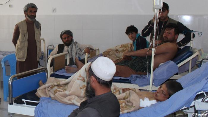 Afghans receive treatment in hospital after an air strike in Kunduz province