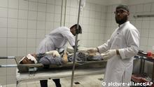 An Afghan man is treated at a hospital following an airstrike in Dashti Archi district of Kunduz province northern Afghanistan, Monday, 2, 2018. An Afghan official says an airstrike on a Taliban training camp in northern Afghanistan killed at least 20 insurgents and wounded many more on Monday, while the Taliban said the airstrike hit a religious school during a graduation ceremony, killing dozens of civilians. (AP Photo) |