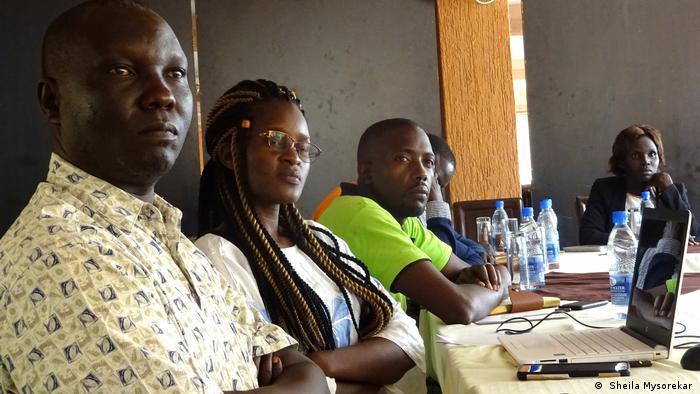 George Driliga, station manager of Morobo FM, and other journalists at a Cross-Border Network meeting in Kampala. ( Sheila Mysorekar )