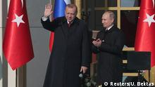 03.04.2018 *** Turkish President Tayyip Erdogan and his Russian counterpart Vladimir Putin attend groundbreaking ceremony of the Akkuyu Nuclear Power Plant through videolink, at the Presidential Palace in Ankara, Turkey April 3, 2018. REUTERS/Umit Bektas