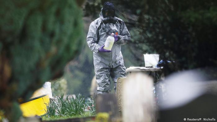 A member of the emergency services wears a protective suits at the site of the grave of Luidmila Skripal,