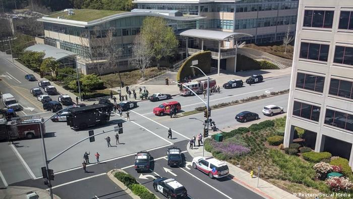Officials are seen following a possible shooting at the headquarters of YouTube, in San Bruno,