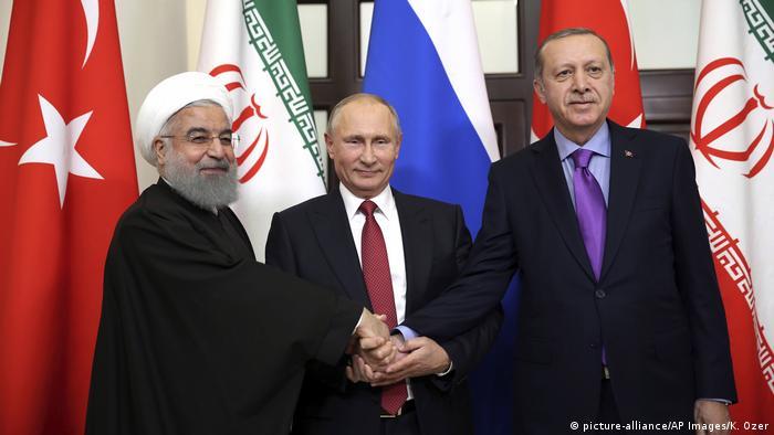 Russland | Präsidenten Erdogan, Putin und Rouhani (picture-alliance/AP Images/K. Ozer)