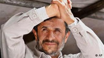 Iranian President Mahmoud Ahmadinejad gestures to thousands of supporters