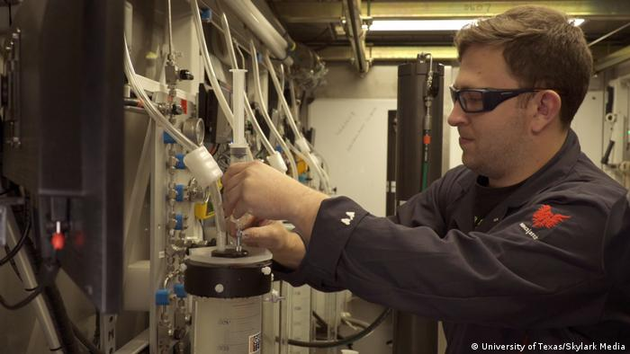 A researcher tests methane hydrate which has been extracted