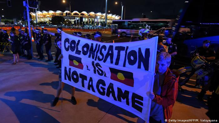 Indigenous activists hold up a banner outside the Commonwealth Games (Getty Images/AFP/M. Vatsyayana)