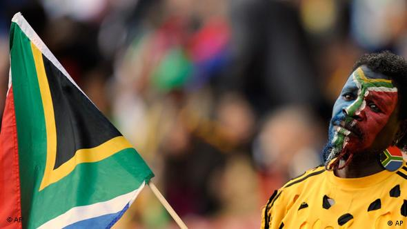 A supporter has the flag of South Africa painted on his face during the opening ceremony of the Confederations Cup soccer tournament at Ellis Park Stadium in Johannesburg, South Africa, Sunday, June 14, 2009. The tournament will run until June 28. (AP Photo/Martin Meissner)