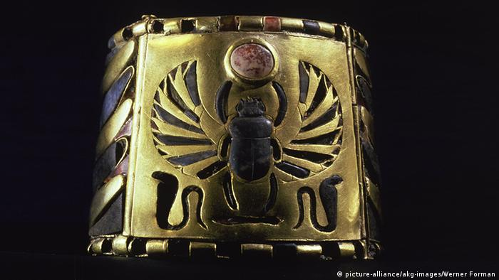 An ancient Egyptian ankle cuff with a beetle design