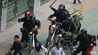Iranian supporters of defeated Iranian presidential candidate Mir Hossein Mousavi are chased by Iranian riot-police
