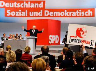 SPD members at a party conference where a banner reads: For a social and democratic Germany