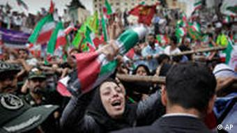 A female supporter reacts, as tens of thousands of supporters of Iranian President Mahmoud Ahmadinejad gather in Vali Asr square for a rally attended by the president, in Tehran, Iran Sunday, June 14, 2009.