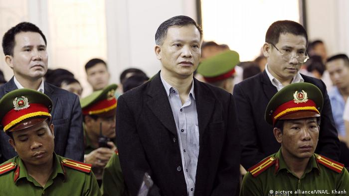 Nguyen Van Dai with co-defendents in the Hanoi court room