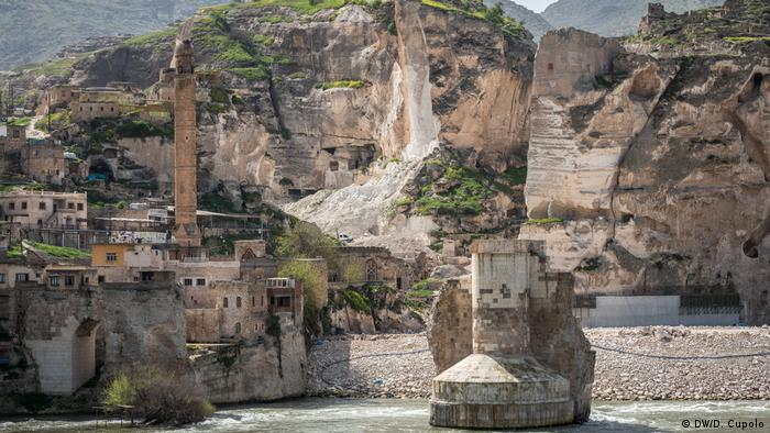 Damaged rock cliffs and earthworks in Hasankeyf, an ancient settlement in southeast Turkey being primed for flooding due to a nearby dam construction