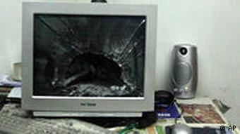 A destroyed computer monitor in a Tehran bedroom