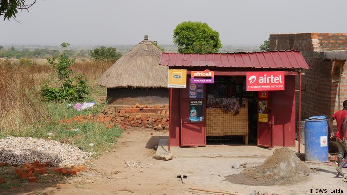 A small red internet provider shack in rural Uganda