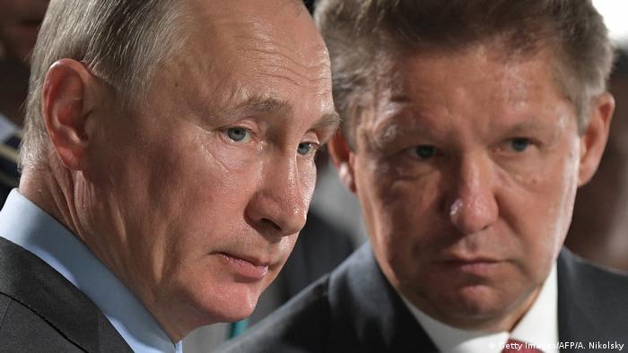 Putin und Gazprom CEO Alexei Miller