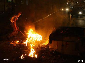 A protestor burns trash in the north of Tehran, Iran in the early hours of Monday, June 15, 2009, in protest of the results of the Iran election.