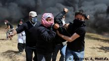 A wounded Palestinian demonstrator is evacuated during clashes with Israeli troops at the Israel-Gaza border at a protest demanding the right to return to their homeland, in the southern Gaza Strip April 6, 2018. REUTERS/Ibraheem Abu Mustafa