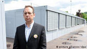 Hardy Schober in front of large metal containers