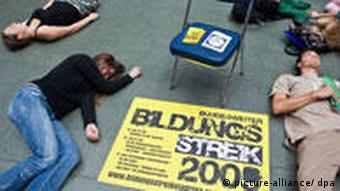 Students at the Viadrina University in Frankfurt lay on the floor in protest
