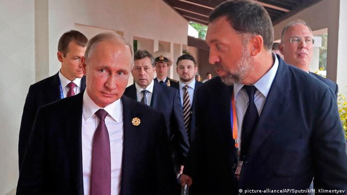 Предприниматель Олег Дерипаска и президент РФ Владимир Путин