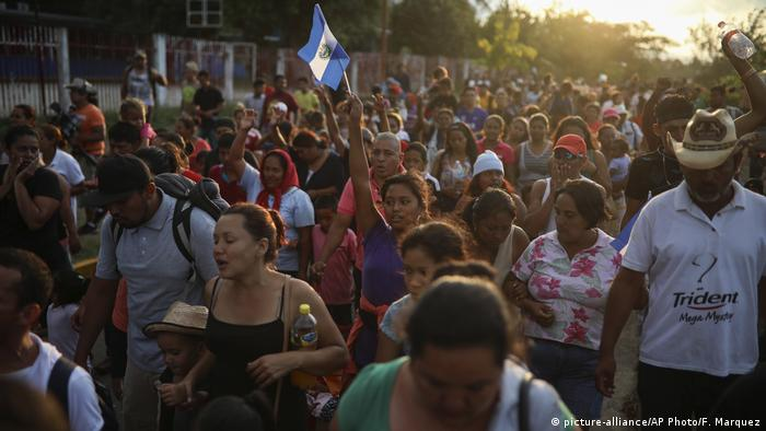 Members of the migrant caravan stage a march in the Mexican city of Oaxaca