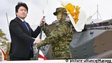 ©Kyodo/MAXPPP - 07/04/2018 ; Senior Vice Defense Minister Tomohiro Yamamoto (L) and Maj. Gen. Shinichi Aoki of the Ground Self-Defense Force attend a ceremony marking the inauguration of Japan's first amphibious fighting force, held in Sasebo, Nagasaki Prefecture, southwestern Japan, on April 7, 2018. (Kyodo) ==Kyodo Foto: MAXPPP |