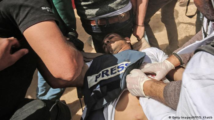Palestinian journalist Yasser Murtaja died from his wounds after being shot on Friday. He is wearing a press vest. (Getty Images/AFP/S. Khatib)