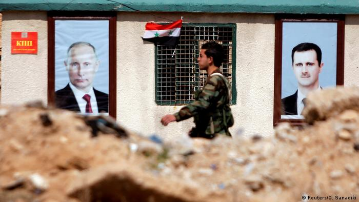 A wall in Ghouta showing portraits of Putin and Assad