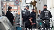 08.04.2018 *** Police officers stand in front of the building where lived the driver of the vehicle which ploughed into an open-air restaurant, killing two people a day earlier in Muenster, western Germany on April 8, 2018. German police were scrambling in the early hours of Sunday to understand the motives of the man who drove a van into a crowd at an open-air restaurant, killing two people before shooting himself. / AFP PHOTO / Michael GOTTSCHALK (Photo credit should read MICHAEL GOTTSCHALK/AFP/Getty Images)