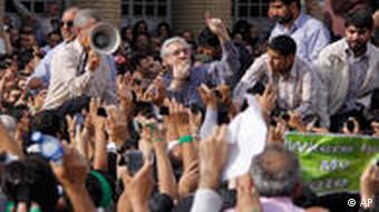 Pro-reform leader Mir Hossein Mousavi, center, speaks to his supporters during a rally in Tehran