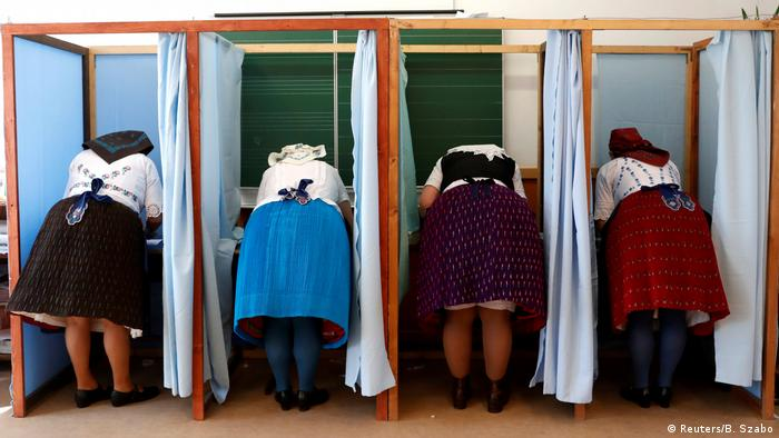 women in traditional dress vote in the 2018 Hungarian elections (Reuters/B. Szabo)