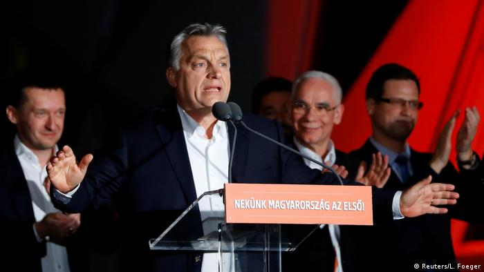 Hungarian Prime Minister Viktor Orban addresses the supporters after the announcement of the partial results of parliamentary election in Budapest (REUTERS)