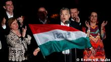 Hungarian Prime Minister Viktor Orban addresses supporters after the announcement of the partial results of parliamentary election in Budapest, Hungary, April 8, 2018. REUTERS/Bernadett Szabo
