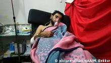 People at hospital after alleged chlorine gas attack in Idlib