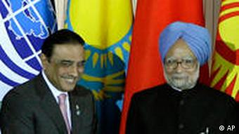 Pakistan President Asif Ali Zardari, left, and Indian Prime Minister Manmohan Singh, right, pose for a photo during a summit of the Shanghai Cooperation Organization in the Ural Mountains city of Yekaterinburg, Russia, Tuesday, June 16, 2009. Russian news agencies are reporting that the leaders of India and Pakistan have met on the sidelines of a summit in Russia. State-run RIA-Novosti and Interfax say Indian Prime Minister Manmohan Singh and Pakistani President Asif Ali Zardari held a bilateral meeting Tuesday. It is the first interaction between the two leaders since the terrorist attacks in the Indian city of Mumbai last November. (AP Photo/Mikhail Metzel)