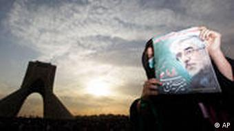 A female demonstrator holds up a poster of leading opposition presidential candidate Mir Hossein Mousavi at a mass rally in Azadi (Freedom) square in Tehran