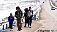 04.04.2018 +++ A group of refugees are seen walking near Erzurum city of eastern Turkey. Thousands of refugees enter from Iranian border to Turkey illegally. Refugees are passing the mountains in the border by foot and arriving to border cities Agri and Igdir in Turkey. Then they walk from Igdır to Erzurum city at eastern Turkey for a hope to reach Istanbul and for a final destination to Europe. Refugees are generally coming from Afghanistan. More than 3,000 Afghans travel this route by walking every day, while nearly 2,000 are sent back, reports Afghanistan s Ministry of Refugees and Returnees. PUBLICATIONxINxGERxSUIxAUTxHUNxONLY Copyright: OnurxSagsoz 15966537