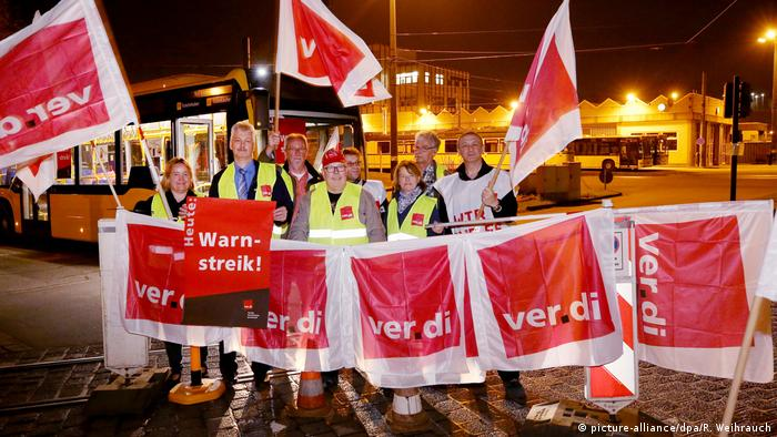 Verdi union members block a bus depot in Essen