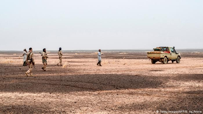 Militants of The Movement for the Salvation of Azawad walk at a waypoint while patrolling along the Mali-Niger border in the deserted area in the Meneka region in Mali during an anti jihadist patrol on February 2, 2018.