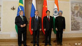 Brazilian President Luiz Inacio Lula da Silva, Russian President Dmitry Medvedev,Chinese President Hu Jintao and Indian Prime Minister Manmohan Singh, from left, seen at the first full-fledged summit of Brazil, Russia, India and China, collectively called BRIC, in the Ural Mountains city of Yekaterinburg, Russia, Tuesday, June 16, 2009. Officials from Russia, China and Brazil have said in recent weeks that they would invest in bonds issued by the International Monetary Fund to diversify their dollar-heavy currency reserves. While BRIC members share a desire to play a bigger role in creating a new global financial order and counterbalancing the West and Japan, their often contradictory interests would make forging a common policy a difficult task.(AP Photo/Mikhail Metzel)