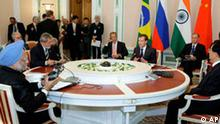 The leaders of Brazil, Russia, India and China, a group collectively called BRIC, attend their first full-fledged summit in the Ural Mountains city of Yekaterinburg, Russia, Tuesday, June 16, 2009. Sitting near the round table, clockwise from left, Indian Prime Minister Manmohan Singh, Brazilian President Luiz Inacio Lula da Silva, Russian Foreign Minister Sergey Lavrov, Russian President Dmitry Medvedev, Russian Security Council chief Nikolai Patrushev, Kremlin aide Sergei Prikhodko, partly seen, and Chinese President Hu Jintao. Brazil, Russia, India and China on Tuesday called for a more diversified international monetary system, but wrapped up their summit by avoiding any explicit criticism of the world's dominant currency, the U.S. dollar. (AP Photo/ RIA Novosti, Vladimir Rodionov, Presidential Press Service)
