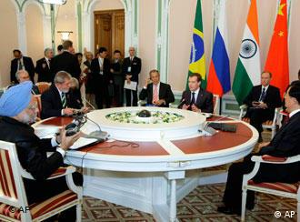 The leaders of Brazil, Russia, India and China, a group collectively called BRIC, attend their first full-fledged summit in Russia