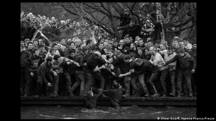 members of opposing teams, the Up'ards and Down'ards, fight for the ball during the historic annual Royal Shrovetide Football Match (Oliver Scarff, Agence France-Presse)