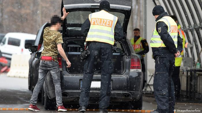 Police check a car at the border between Germany and Austria
