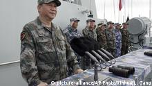 In this April 12, 2018 photo released by Xinhua News Agency, Chinese President Xi Jinping, left, speaks after he reviewed the Chinese People's Liberation Army (PLA) Navy fleet in the South China Sea. China has announced live-fire military exercises in the Taiwan Strait amid heightened tensions over increased American support for Taiwan. The announcement by authorities in the coastal province of Fujian on Thursday was accompanied by a statement that the navy was ending a three-day exercise in the South China one day early. (Li Gang/Xinhua via AP) |