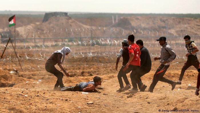 Protesters injured in Gaza City (Getty Images/AFP/M. Hams)