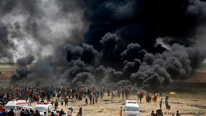 Protesters burned tires at the border fence east of Jabalia
